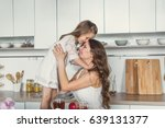 mom and daughter in the kitchen. | Shutterstock . vector #639131377