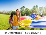 pretty girl playing parachute... | Shutterstock . vector #639153247