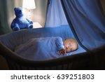 adorable baby drinking milk in... | Shutterstock . vector #639251803