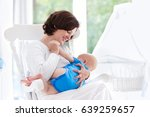 mother and baby at home. young... | Shutterstock . vector #639259657
