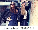 fashion portrait of two young... | Shutterstock . vector #639351643