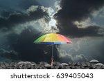 hand holding rainbow umbrella... | Shutterstock . vector #639405043