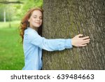 contented young woman hugging a ... | Shutterstock . vector #639484663