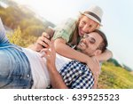 happy young couple enjoying a... | Shutterstock . vector #639525523