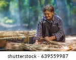 old asian woman making roof of... | Shutterstock . vector #639559987