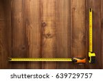 tape measure tools on wooden... | Shutterstock . vector #639729757