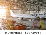 airliner aircraft in a hangar... | Shutterstock . vector #639739957