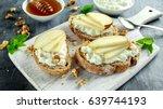 appetizer bruschetta with pear  ... | Shutterstock . vector #639744193