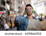 man travels with map . young... | Shutterstock . vector #639866503
