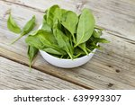 spinach in a white bowl on a...   Shutterstock . vector #639993307
