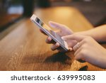 hand of woman using smartphone... | Shutterstock . vector #639995083