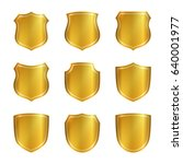 gold shield shape icons set. 3d ... | Shutterstock .eps vector #640001977