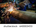 worker cutting steel pipe with... | Shutterstock . vector #640003453
