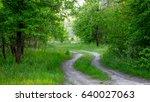 scene with dirt road in green... | Shutterstock . vector #640027063