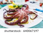 grilled octopus on white plate. ... | Shutterstock . vector #640067197