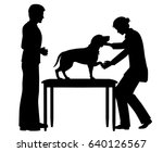 Stock vector editable vector silhouette of a female vet examining a pet dog with figures as separate objects 640126567