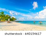 beach chairs with umbrella at... | Shutterstock . vector #640154617