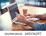 man with laptop and phone | Shutterstock . vector #640156297