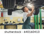 young mechanic in garage | Shutterstock . vector #640160413