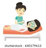 cosmetologist applying mask on... | Shutterstock .eps vector #640179613