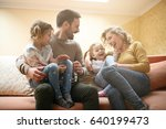 happy family at home spending... | Shutterstock . vector #640199473