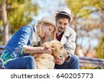 Stock photo young couple is enjoying walking with dog early in the morning 640205773