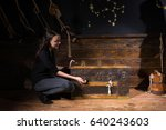 young girl sits near a chest... | Shutterstock . vector #640243603