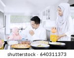 happy family eating together in ... | Shutterstock . vector #640311373