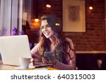 happy woman using laptop and... | Shutterstock . vector #640315003