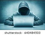 Small photo of concept defense and espionage of confidential information / Hacker - Good knowledge in computer systems as well / Can access the information by punching through a security system.