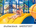 father and son on a water slide ... | Shutterstock . vector #640537357
