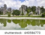 huge rocks  trees and lake in... | Shutterstock . vector #640586773