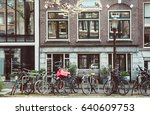 vintage bicycles lining houses... | Shutterstock . vector #640609753