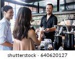 cheerful bartender serving... | Shutterstock . vector #640620127