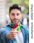 close up of a man eating ice... | Shutterstock . vector #640672963