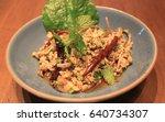 Small photo of Lab Moo is spicy pork salad. It always eat with papaya salad. Lab Moo on the wood table. Thai food , Isan Food , Lao food.
