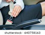 business woman fastening seat