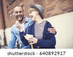 young woman feeding boyfriend... | Shutterstock . vector #640892917