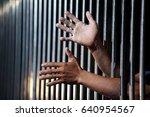 hands of prisoner in jail as... | Shutterstock . vector #640954567