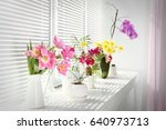 beautiful flowers and home... | Shutterstock . vector #640973713