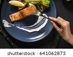 women hands with fork  top view. | Shutterstock . vector #641062873