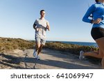 sport runner jogging on beach... | Shutterstock . vector #641069947