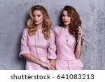 portrait of two woman wear... | Shutterstock . vector #641083213