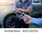 photo of car dealer selling car ... | Shutterstock . vector #641110153