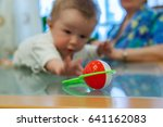 little baby boy is crawling and ... | Shutterstock . vector #641162083