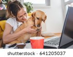 woman embracing dog sitting on... | Shutterstock . vector #641205037