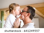 young father with his cute... | Shutterstock . vector #641249557