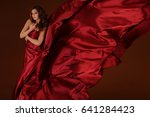 beautiful girl in a flowing... | Shutterstock . vector #641284423