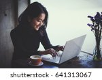 asian  woman working with her...   Shutterstock . vector #641313067