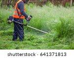 the gardener cutting grass by... | Shutterstock . vector #641371813